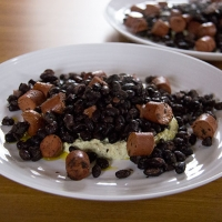 Black beans and hot dogs with houmous