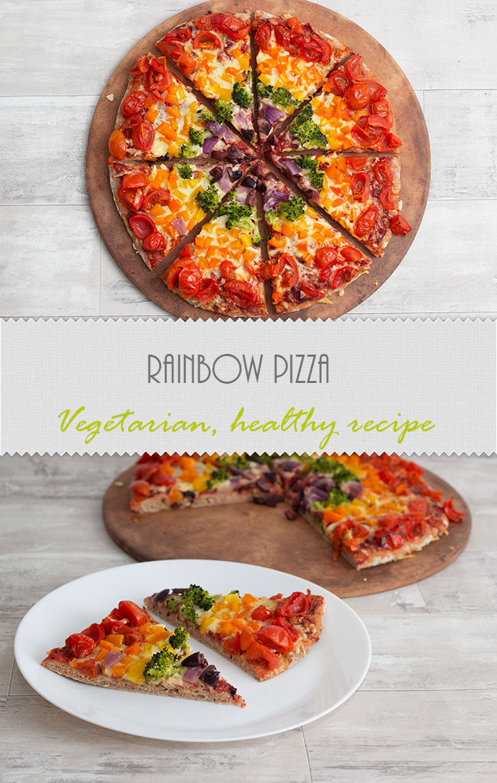 Rainbow pizza idea with lots of veggies: tomatoes, orange pepper, yellow pepper, broccoli, red onion and kalamata olives.