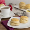 Orange scones, clotted cream, tea, orange jam