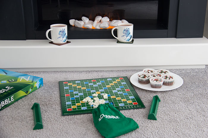 Cupcakes, games, and hot chocolate. Near the fireplace