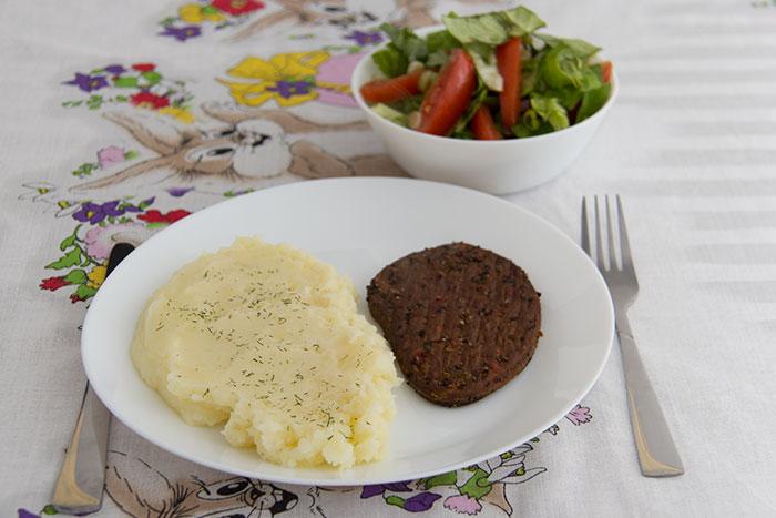 Vegetarian Steak, mash potatoes and salad