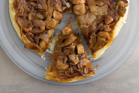 Mushrooms and Onions Tarte Tatin. Slice of tarte