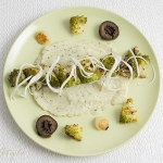 Roasted romanesco with herby mash, cheese, onions and pickled walnuts