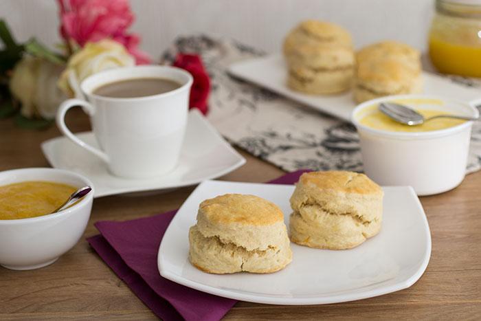 Orange scones, clotted cream, tea, orange jam