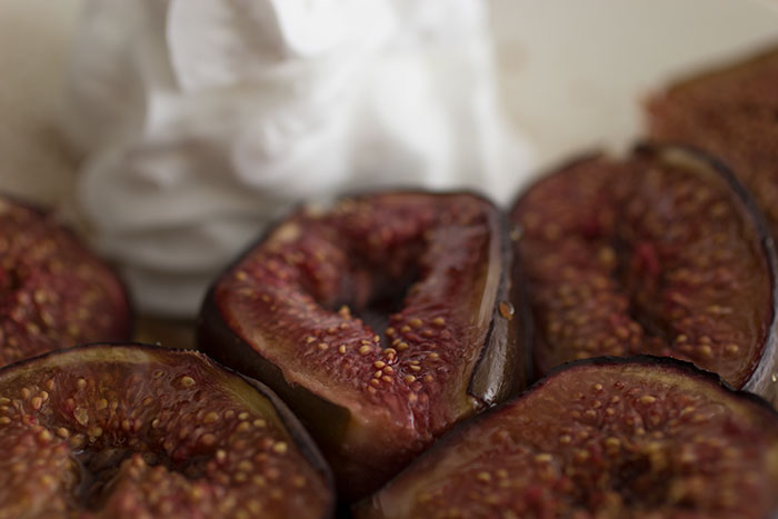 Roasted figs with whipped cream. Close up